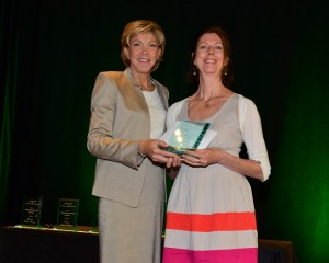 Leigh-Anne Stradeski accepts the 2014 Promising Practice Award from Pattie Dyer from MetLife