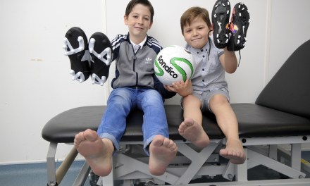 Football mad brothers receive new feet for Christmas