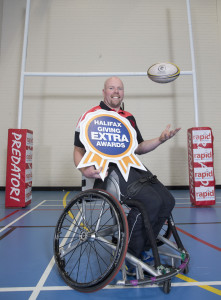Phil Roberts  celebrates winning the local Halifax Giving Extra Awards for Lancs West.