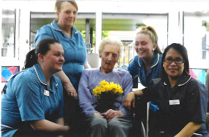 Susie Rogers (middle) with staff at