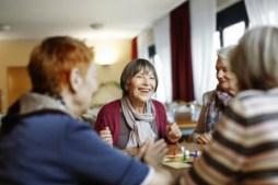 Senior Women Playing Board Game