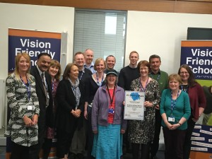Staff from Bardford Council's visual impairment team celebrate the award of their quality mark