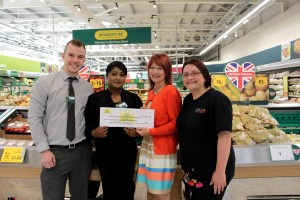 Matthew Caunt, Trading Manager and Korful Bibi, People Manager from Morrisons Elland, hand over the cheque to Trizia Wells, Inclusion Manager and Lorraine Muldoon, Inclusion Enabler from Eureka! The National Children's Museum