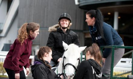 People with learning disabilities have their first horse-riding lessons at Aintree