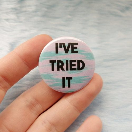 "A hand holding a badge which has bold black text, which reads ""I've tried it"""