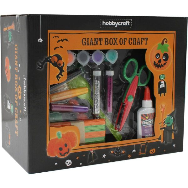A large box in halloween colours with a clear front, filled with glitter, glue and craft essentials