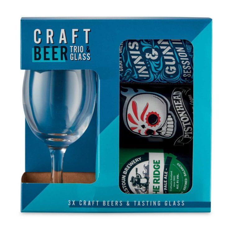 A blue box containing a stemmed beer mug and three cans of craft beer.
