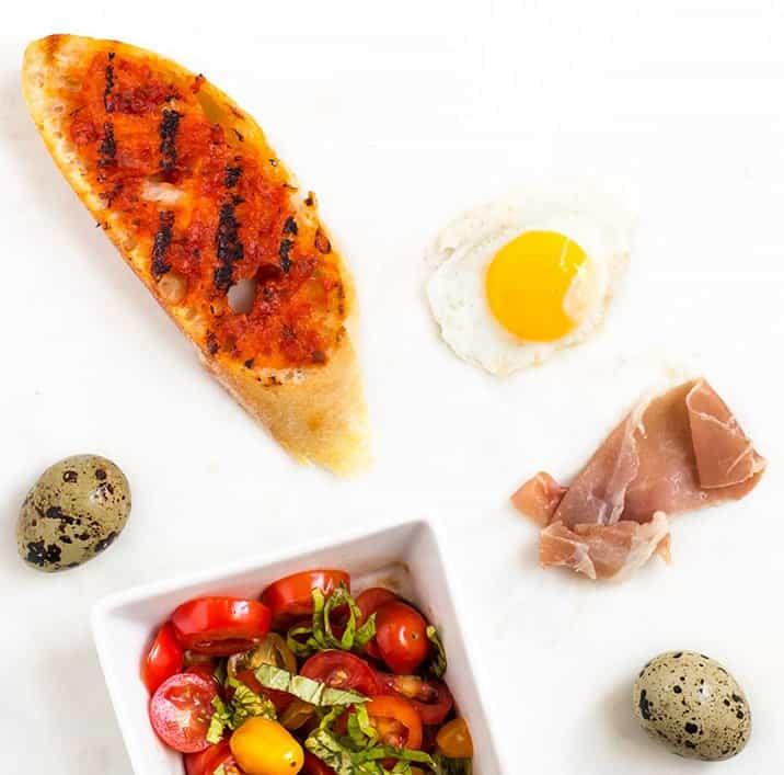 Bruschetta with Prosciutto, Tomato Basil and Quail Egg