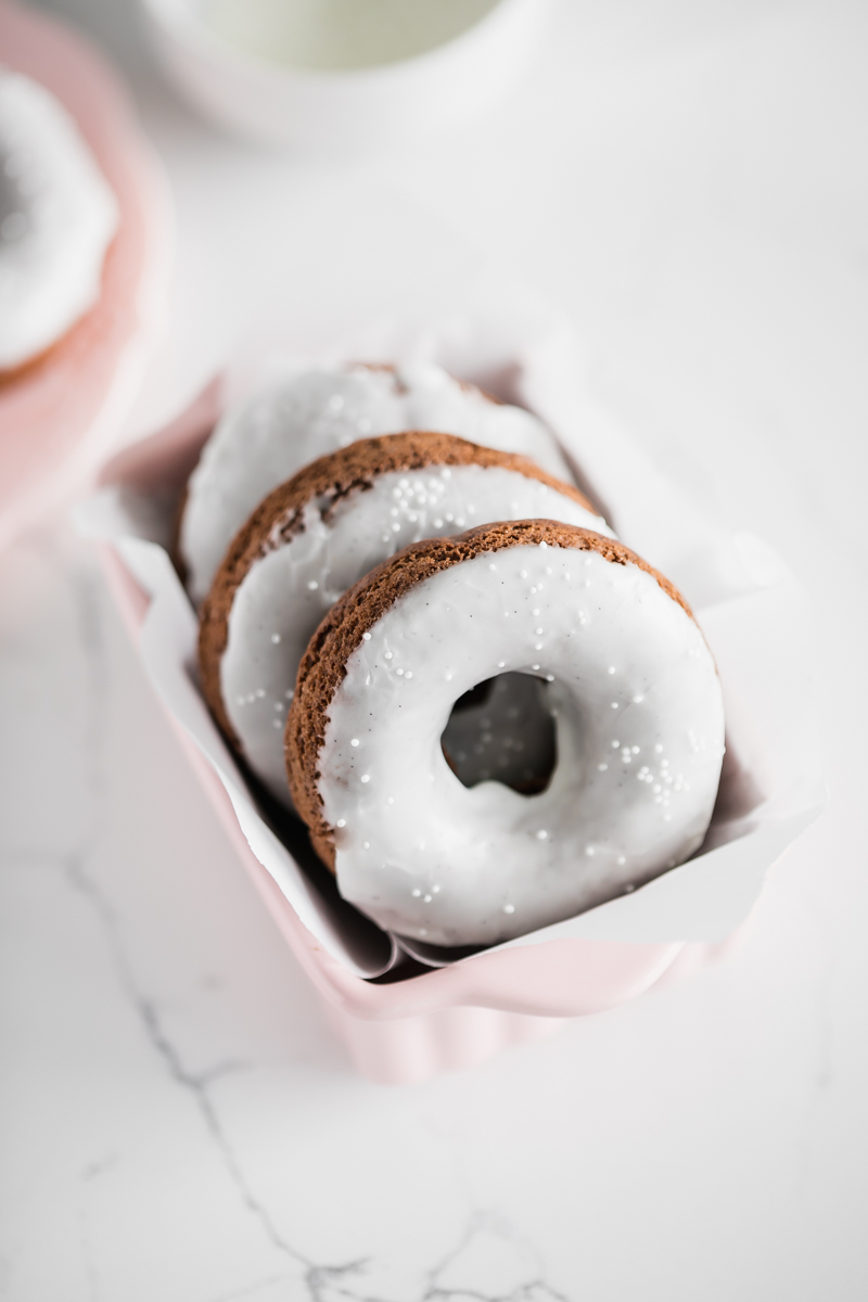 recipe for small batch gluten free chocolate donuts with vanilla glaze. Also dairy free