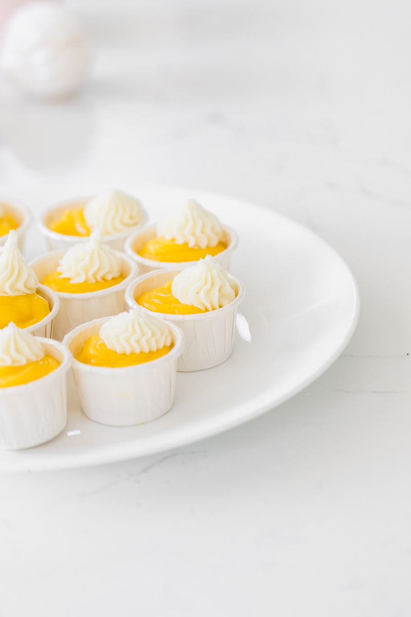 miniature mango curd cake cups with vanilla frosting