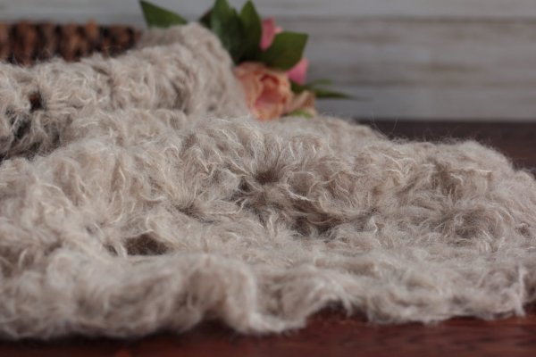 Textured neutral wrap for newborn photography.