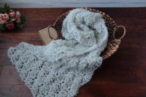 Delicate neutral newborn wrap for photoshoot