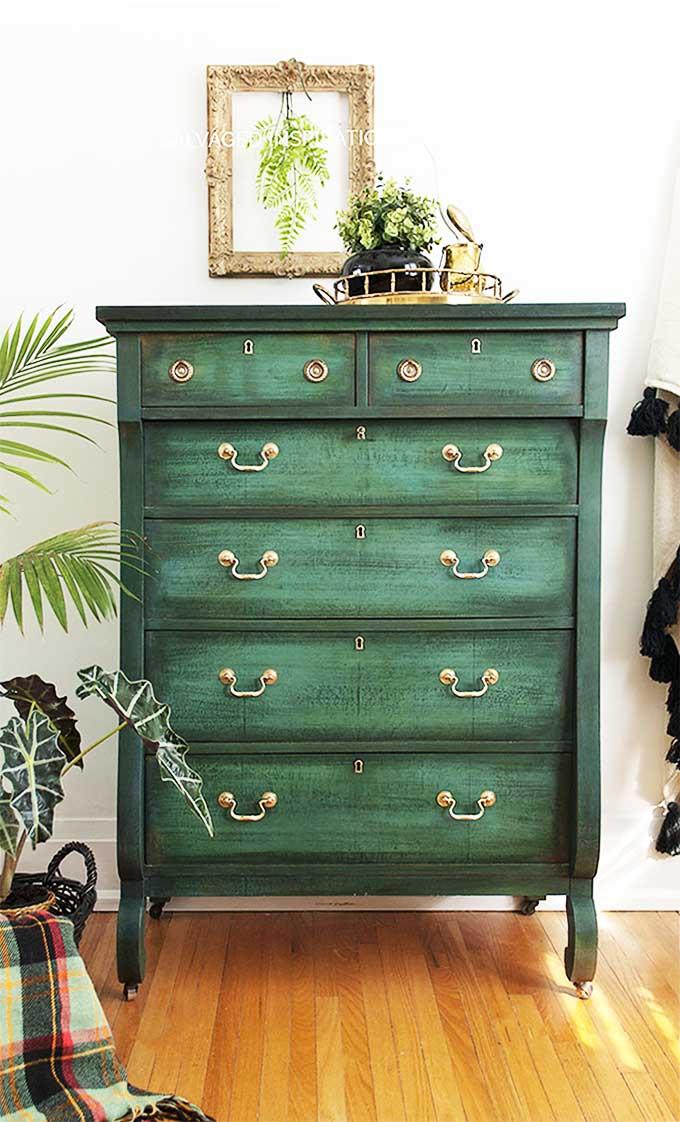 Layered green chalk paint on an antique dresser