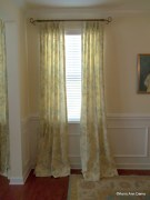 Soft floral linen draperies in a dining room