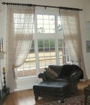 Large window on golf course with patterned sheers