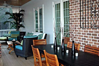Outdoor room with modern wicker and teak furniture.