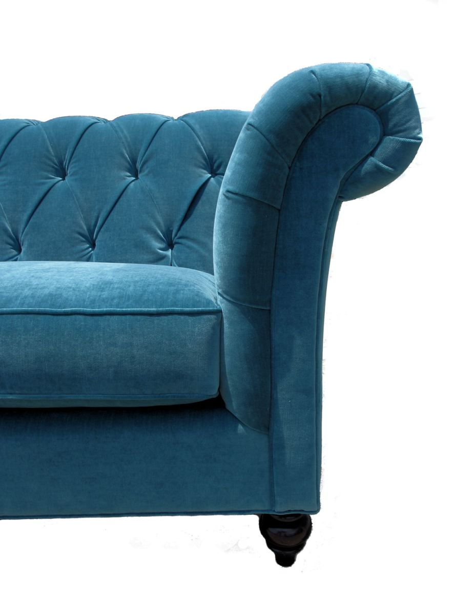 Tufted sofa in durable peacock velvet