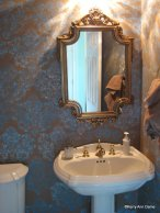 Hand-stenciled powder room walls
