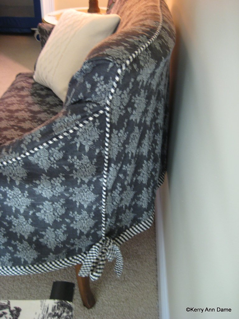 Slipcovered French settee in black rose mini-damask, ticking trim