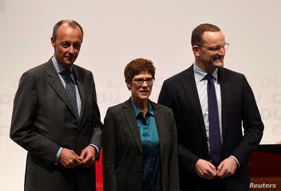 Christian Democratic Union (CDU) candidates Friedrich Merz, Annegret Kramp-Karrenbauer and Jens Spahn arrive at a regional conference in Luebeck, Germany, Nov. 15, 2018.