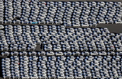 New Porsche cars are parked at the grounds of the Porsche plant in Leipzig, eastern Germany, on November 3, 2015.