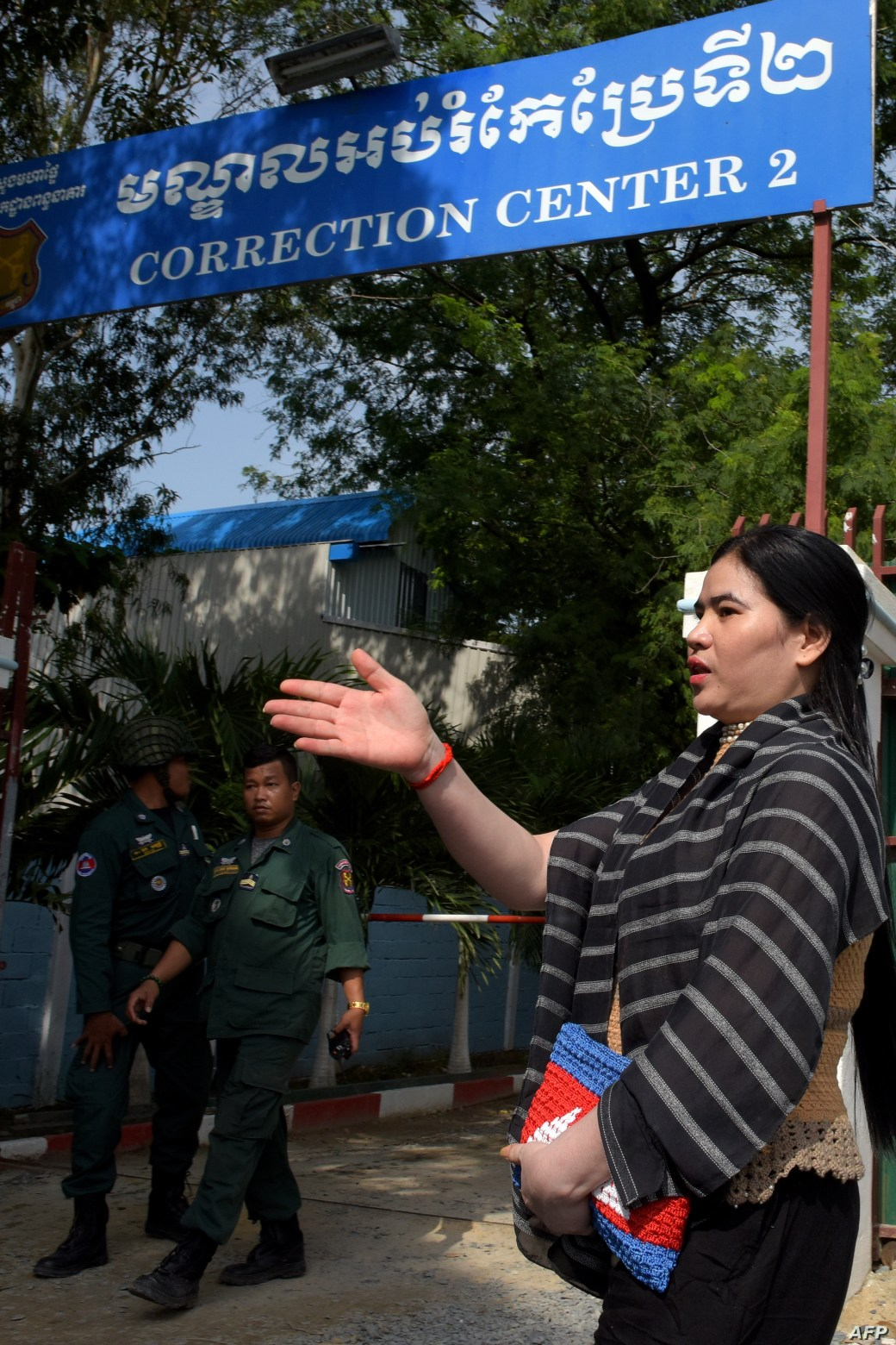 FILE - Cambodian land activist Tep Vanny speaks to journalists outside Prey Sar prison in Phnom Penh, Aug. 21, 2018.