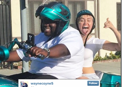 Miley Cyrus Jumps On Motorcycle with Aquaman!
