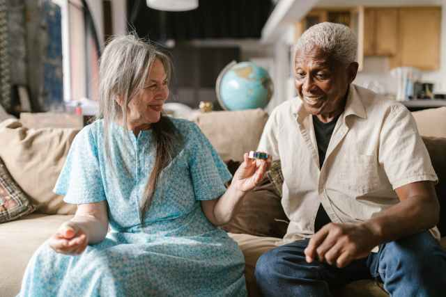 elderly woman showing a metal grinder