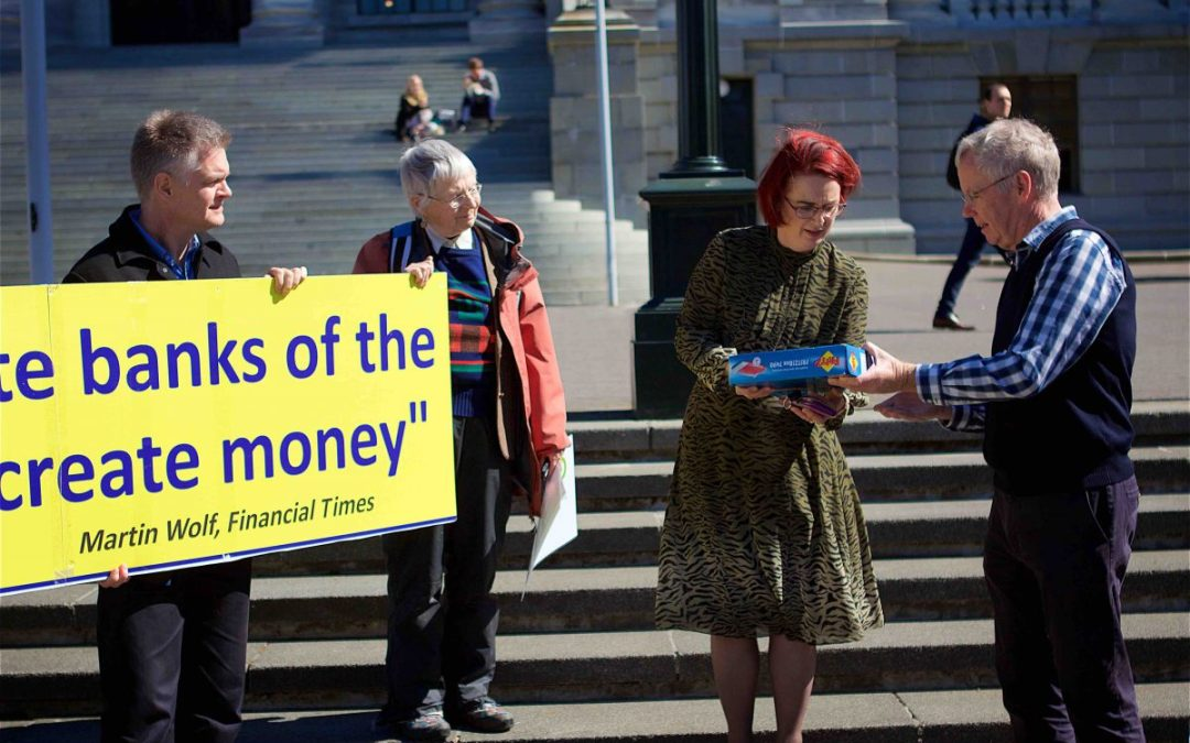 Positive Money NZ team handing over petition to MP Dr Deborah Russell on the steps of the New Zealand Parliament.