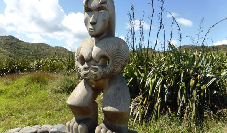 The carved pou symbolises the spiritual guardianship of Te Kawerau a Maki and recognises that this is a special place, being one of the oldest settled parts of the Waitakere Ranges