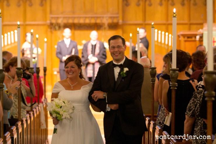 Smiling all the way down the aisle! Photo by Aaron Babcock