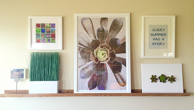 Our fourth anniversary gift fits in great with this gallery wall/shelf in our dining room.