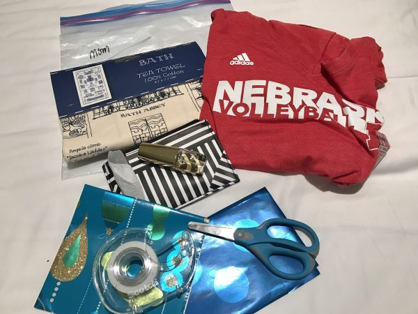 For my mom, we brought a tea towel from our trip to Bath, England, last summer, a Nebraska volleyball shirt, and her favorite perfume. I pre-measured pieces of wrapping paper before we left, and brought tape and scissors in my suitcase.