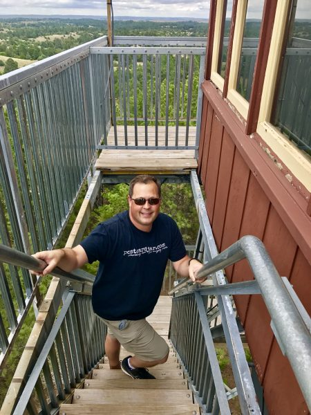 Steve climbs Scott Lookout Tower, Nebraska National Forest
