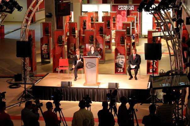 Ann delivering a speech on behalf of her company at the opening of the Kansas City Chiefs Hall of Honor.