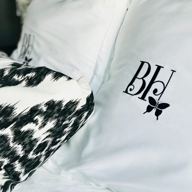 All of the beds have luxurious bedding with embroidered pillow shams