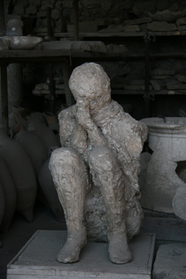 A Pompeii citizen trying to protect themselves from the heat and ash.