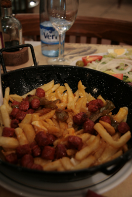 Spanish sausage meat with chips and egg.