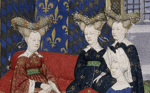 """Christine de Pisan presents her book to Queen Isabeau of France. She and her ladies wear jewelled heart-shaped stuffed or hollow """"bourrelets"""" on top of hair dressed in horns. Christine wears a divided hennin covered in white cloth. c 1410 - 1414"""