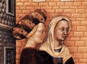 One women is wearing a simple veil while the other is wearing a bourrelet with her hair up under it.