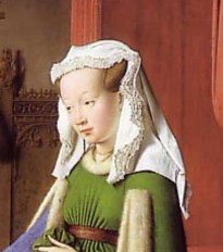 She is wearing her hair in cauls and a kruseler veil over. Notice her shaved forhead, 1434