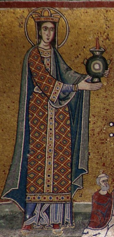 Woman wearing a long sleeved embroidered surcote over a blue cote. She is also wearing a mantle. Note the embroidering down the middle of the surcote. 1200's