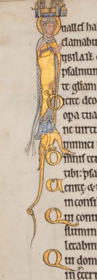 The lady has a braid longer than to her feet! She is also wearing a mantle and a wrapped veil over a cote and overdress. c. 1170