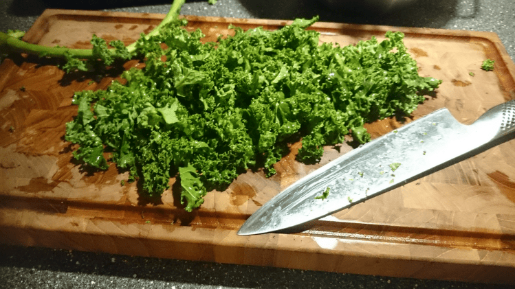 Cutting kale, make sure to remove the stem
