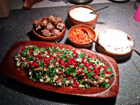 My Moroccan twist on the salad. Here the salad has pearl barley, parsley, cucumber and bell pepper and is topped with pomegranate seeds. On the side is a tzatziki and another yogut dressing. We had spiced meat balls and a tomato dish on the side.