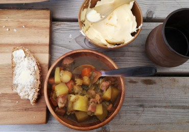 Medieval soup of root vegetable with pork bacon
