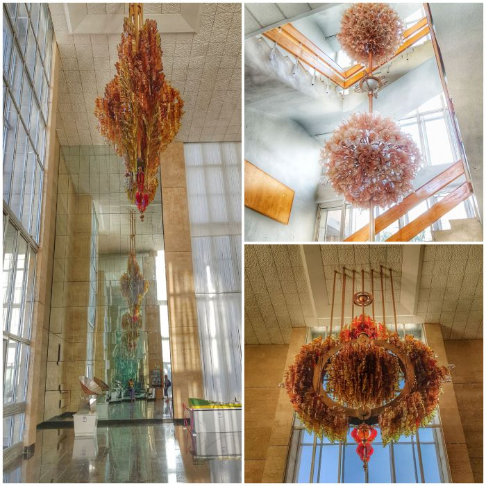 Chandeliers inspired by the sun in the entrance hall Photo by Freda Hughes
