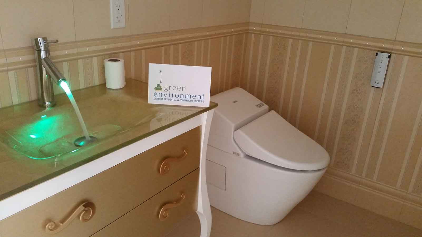 Remodeled luxury bathroom with wood paneled walls, post-construction cleaning by Post Green Cleaning.