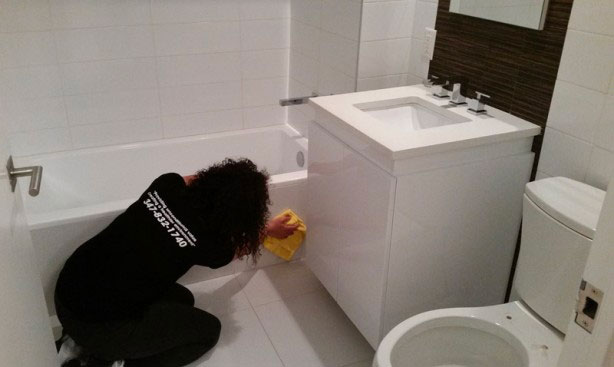 Customers are the heart of our business; a bathroom post construction cleaning project with service worker