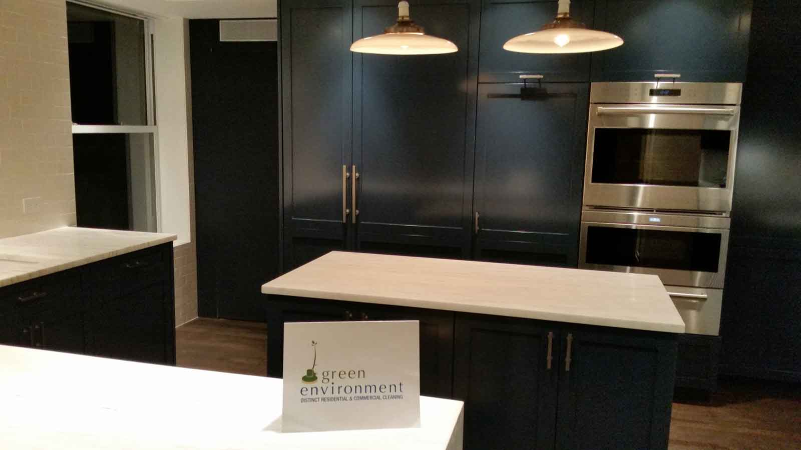 Kitchen with black cabinets and white counters.